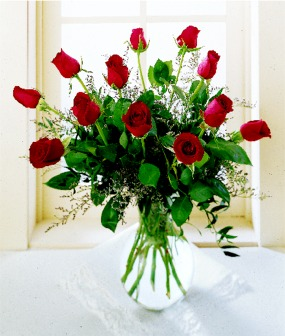 A Dozen Long Stem Roses with Filler and Greens in a Vase