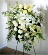 A Quiet Tribute in a monochromatic color scheme of White and Off-White Spray Roses, Lilies, Carnations and Dendrobium Orchids