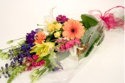 presentation bouquet of seasonal flowers hand selected for color and style