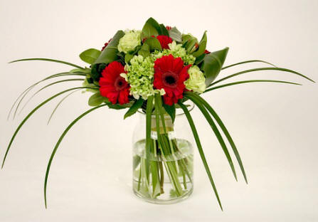 Tropical Ti leaves embrace this sophisticated hand-tied bouquet